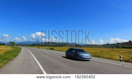 moving car on the lane blue sky background in Chiang rai Thailand