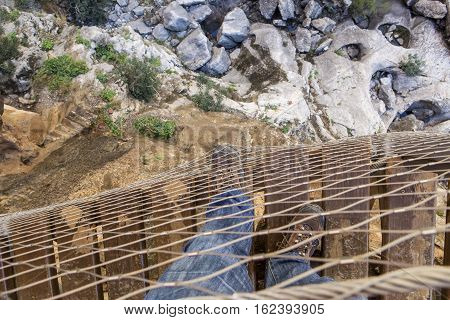 Trekking shoes on footbridge at Caminito del Rey path Malaga Spain