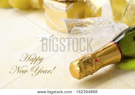 The bottle of champagne with two two elegant flutes and Christmas decoration. 2017 Happy New Year concept. Copy space