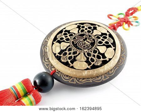 Chinese decoration mobile made of coconut shell carving isolated on white background, character