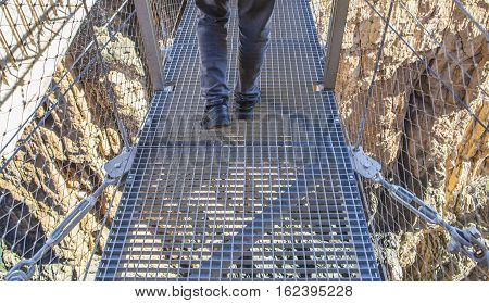 Trekking shoes over suspension bridge at Caminito del Rey path Malaga Spain