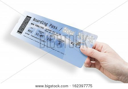 Hand of a woman holding a airplane ticket to New York - image isolated on white. The contents of the image are totally invented. Background images of the ticket are my property.
