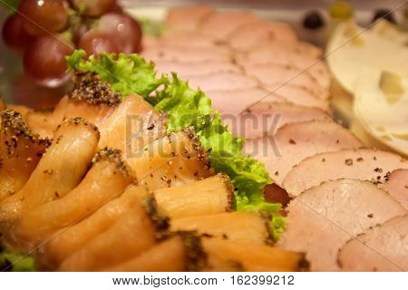 Assorted meat slices in a buffet restaurant