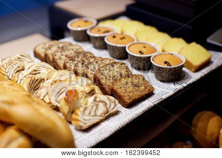Assorted pastries and bread in buffet in restaurant