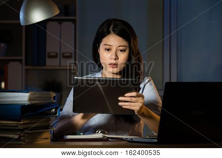 Asian Business Woman Use Digital Tablet Working Overtime