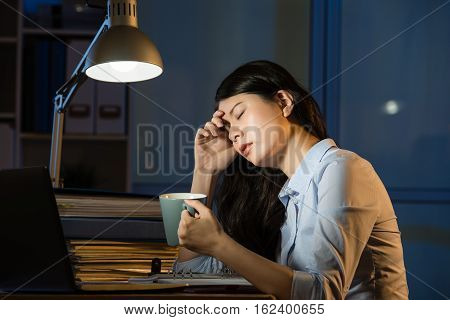 Asian Business Woman Drink Coffee Refreshing Working Overtime Late