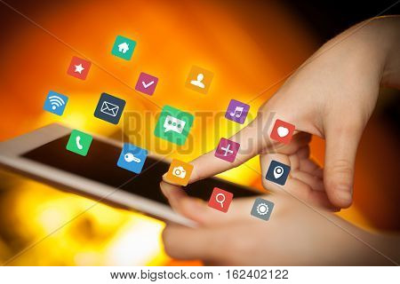 Female hands touching tablet with colorful applications