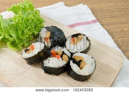 Japanese Cuisine Fresh Veggie Sushi Rolls or Vegetable Maki with Green Oak Served on Wooden Tray.