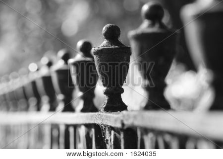 an abstract black and white of fence posts. poster