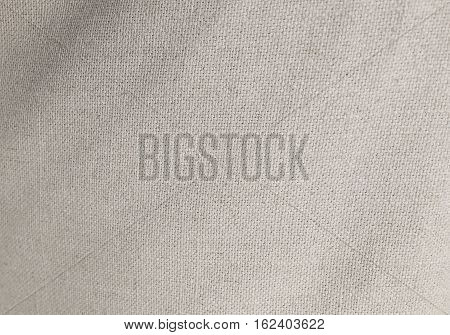 Textile Texture Close Up of White Sack or Burlap Fabric Pattern Background with Copy Space for Text Decoration.