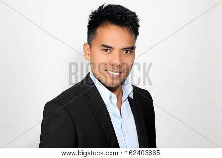 Portrait of an attractive Filipino over a white background