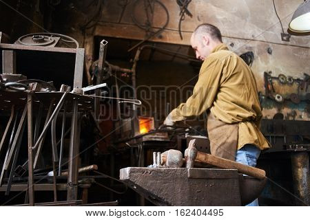 Anvil amid the busy forge to heat items in the oven