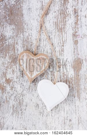 wooden hearts on a white wooden background