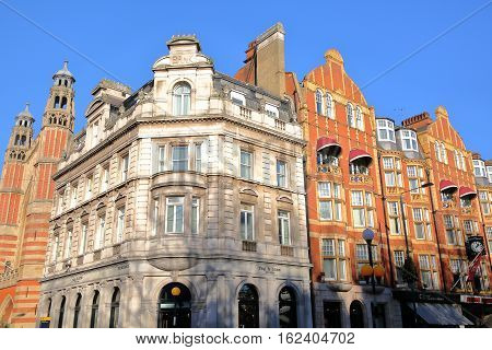 LONDON, UK - NOVEMBER 28, 2016: Colorful Victorian houses facades at Sloane Square in the borough of Kensington and Chelsea