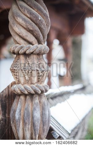 Detail of a wooden carved door column in Maramures Romania.