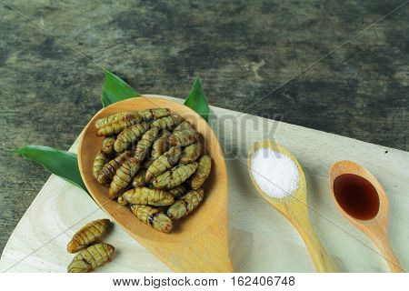 silkworm pupae, Asian food, cooking by steam or deep fry