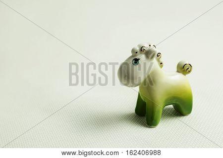 Porcelain toy horsy on a light background