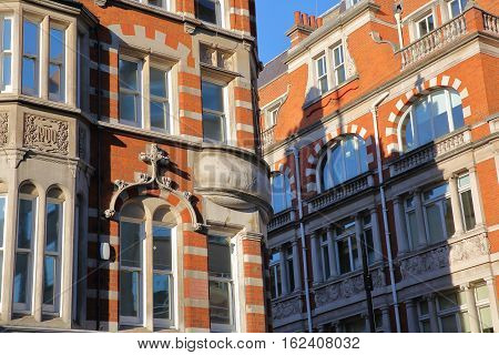 LONDON, UK: Red brick Victorian houses facades in the borough of Westminster poster