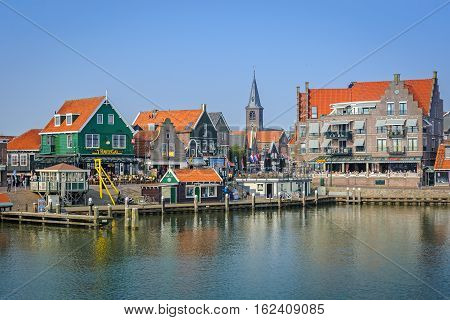 VOLENDAM, NORTH HOLLAND/ THE NETHERLANDS - APRIL 2, 2014: View of Volendam harbor from the  ferry. Volendam is a very popular touristic destination in North Holland