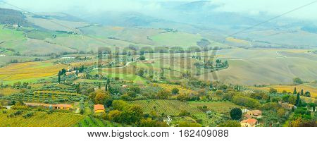 tuscany panoramic banner landscape with wave hills, cypresses trees, green grass in Tuscany, Italy, Europe