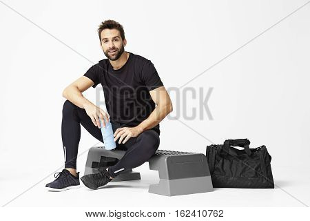 Dude resting after workout in studio portrait