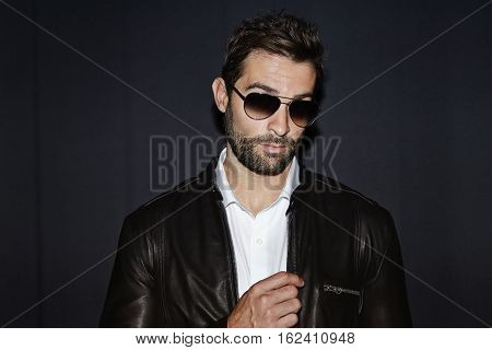 Dude in shades and leather jacket looking cool