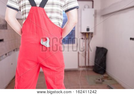 Back View Of Male Fitter Holding Spanner