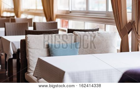 Cozy cafe for family dinner. Classic modern neoteric interior of the cafe full of furniture and represented in the minimal design