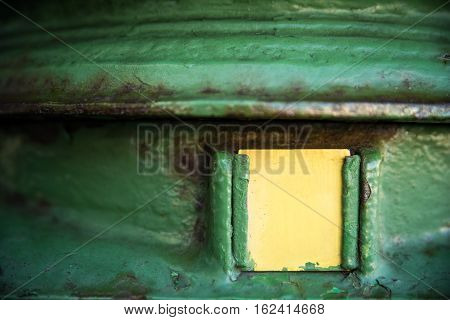 Old green irish postbox with copyspace on yellow label