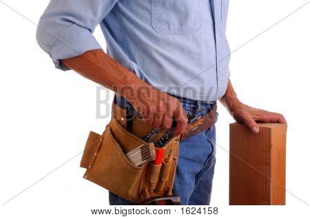 Carpenter Holding Wood