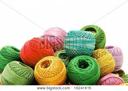 spools of many colors on a white background