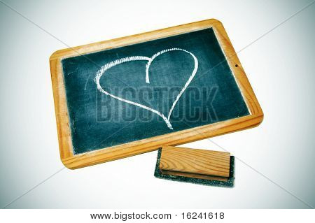 a heart drawn on a blackboard chalk