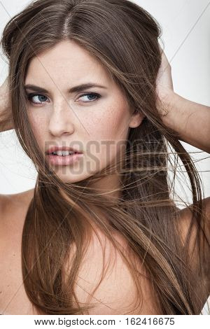 strong facial expression concept - young woman portrait with displeased negative grimace on her face