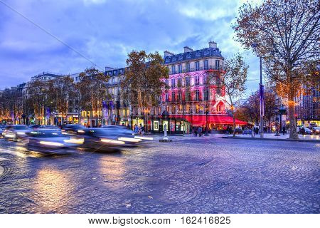 ParisFrance - 27 November 2016: Dusk image of the famous Champs Elysees Boulevard in Paris festive decorated during the winter holidays.