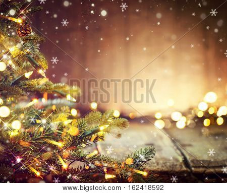 Christmas Holiday blurred Background with Christmas tree and garlands. Christmas table background. Beautiful Empty Christmas room. New Year Frame for your text.