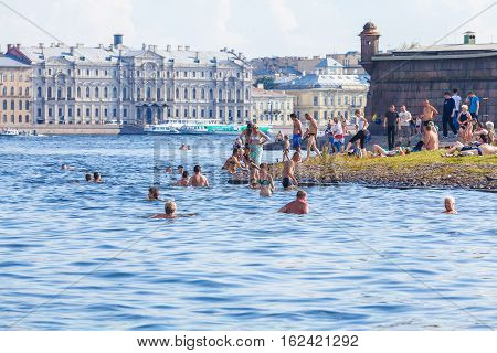 Saint Petersburg, Russia - July 26, 2014:  Residents Swim In The River Neva On The Beach Near The Pe