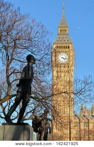 LONDON, UK - MARCH 16, 2014: Big Ben Clock tower with Parliament Square Statues in the foreground