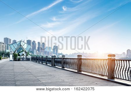 Chongqing city skyline with wooden floors and guardrails.