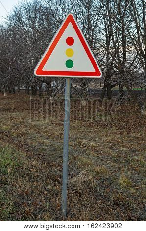 Road sign warning about traffic light regulation of the European standard