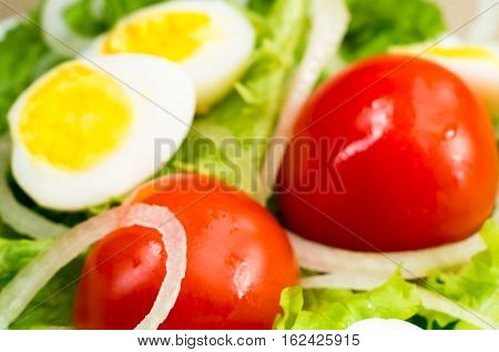 Blurred Image Of Cherry Tomatoes In A Salad