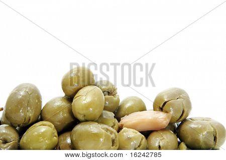 lot of black olives on awhite background