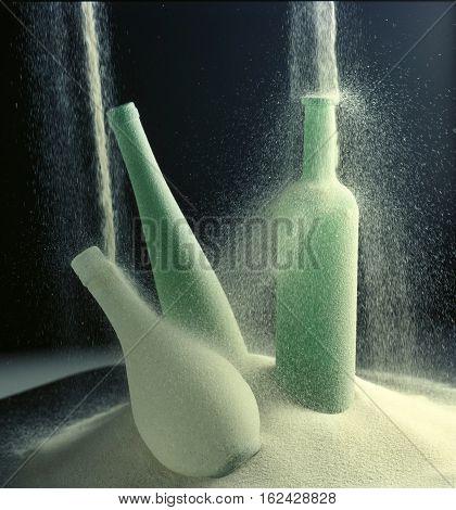 glass bottles studded with quartz sand alcohol