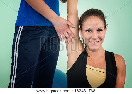 Physical therapy: working on shoulder flexion, toned image