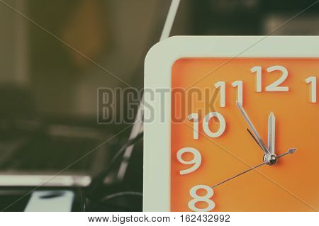 Clock counting for lunch time break on office table.