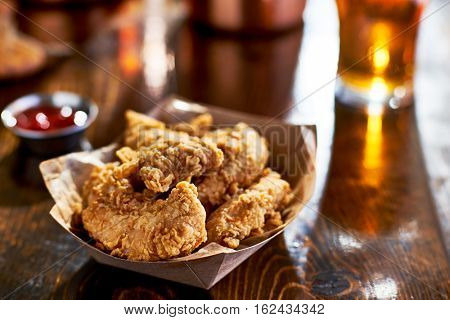 fried chicken tenders in paper basket