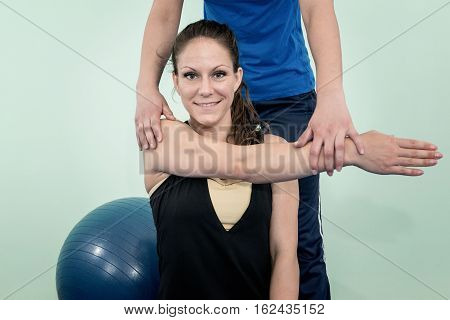 Physical therapy: improving shoulder flexion, toned image