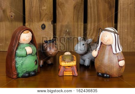 Christmas scene with figurines. Baby Jesus Mary Joseph