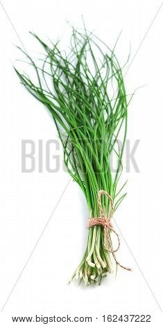 Green onions on a white background close up.