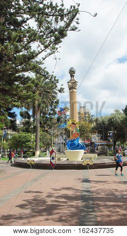 Ambato, Tungurahua / Ecuador - December 17 2016: People walking in the 12 de Noviembre Park. This place was a strategic point for the commerce of the city in century XX