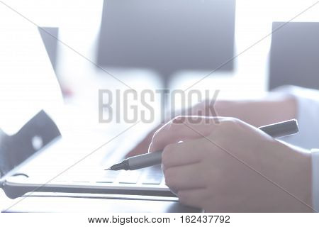 Closeup of a male hands busy typing on a laptop